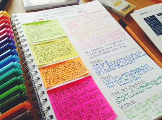 A close up of revision notes and a pack of coloured fineliners