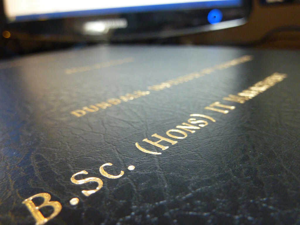 Close up of gold letters on a black thesis book