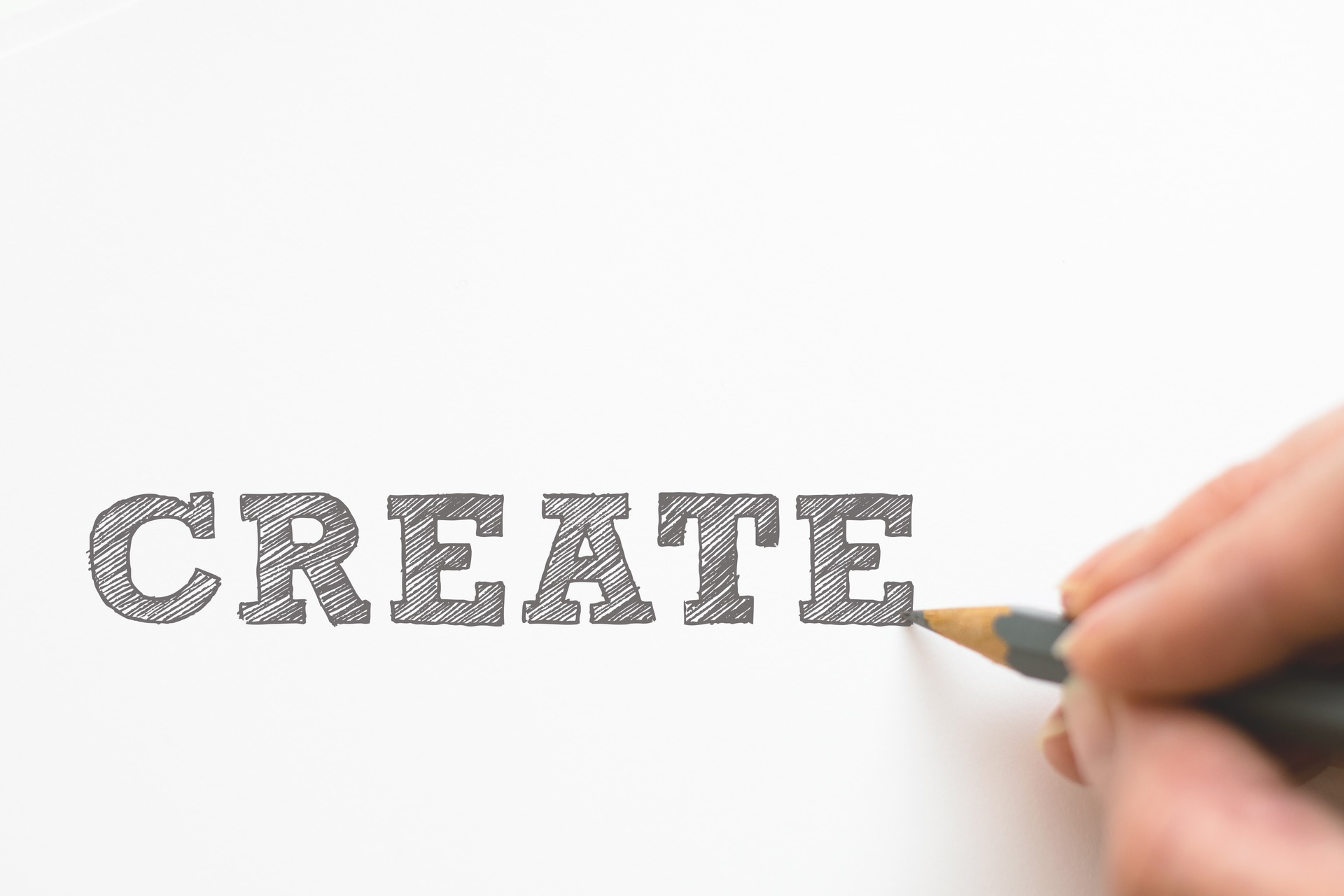 The word CREATE in grey and capital letters