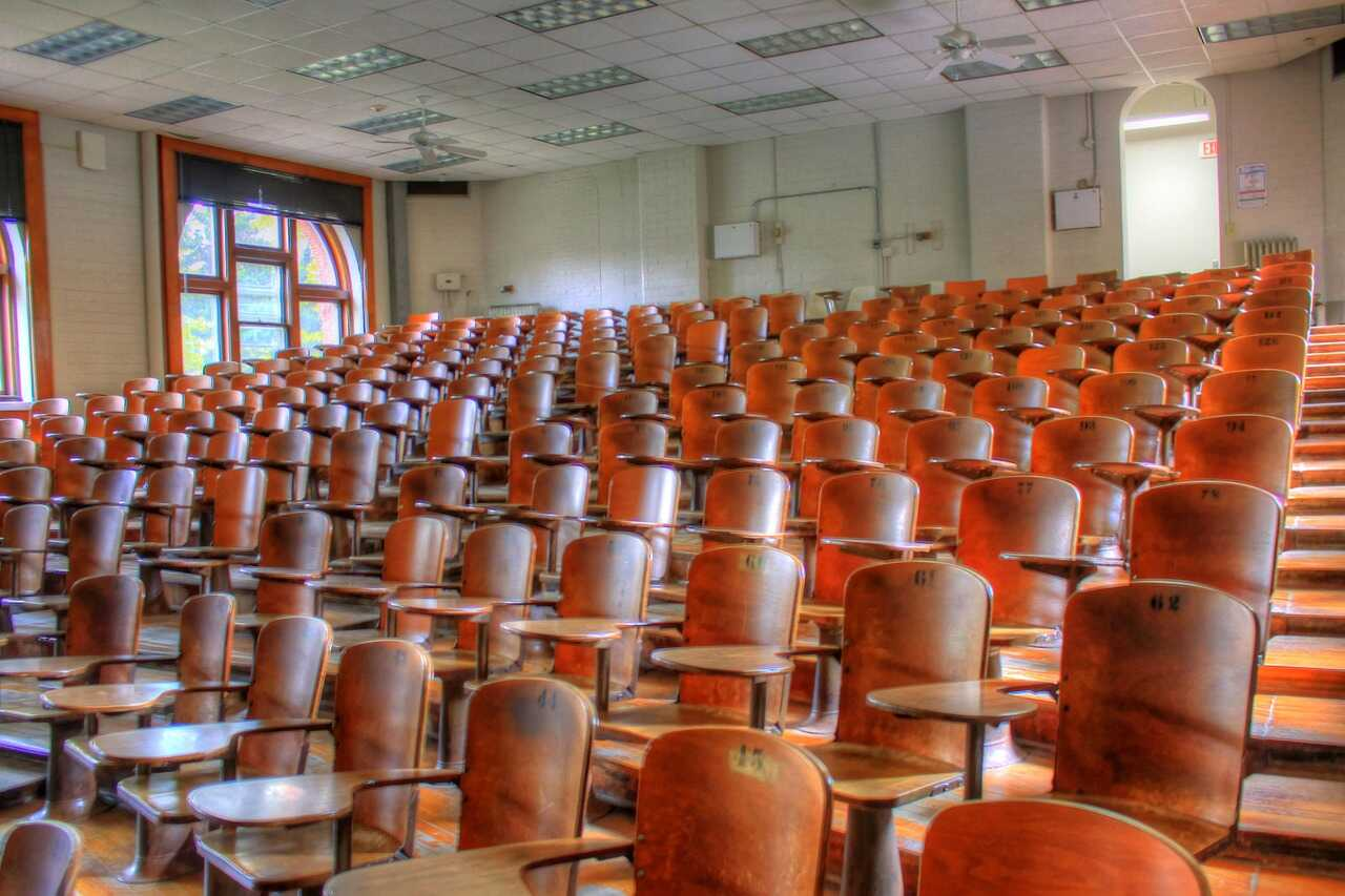 Wooden seats in an empty lecture hall