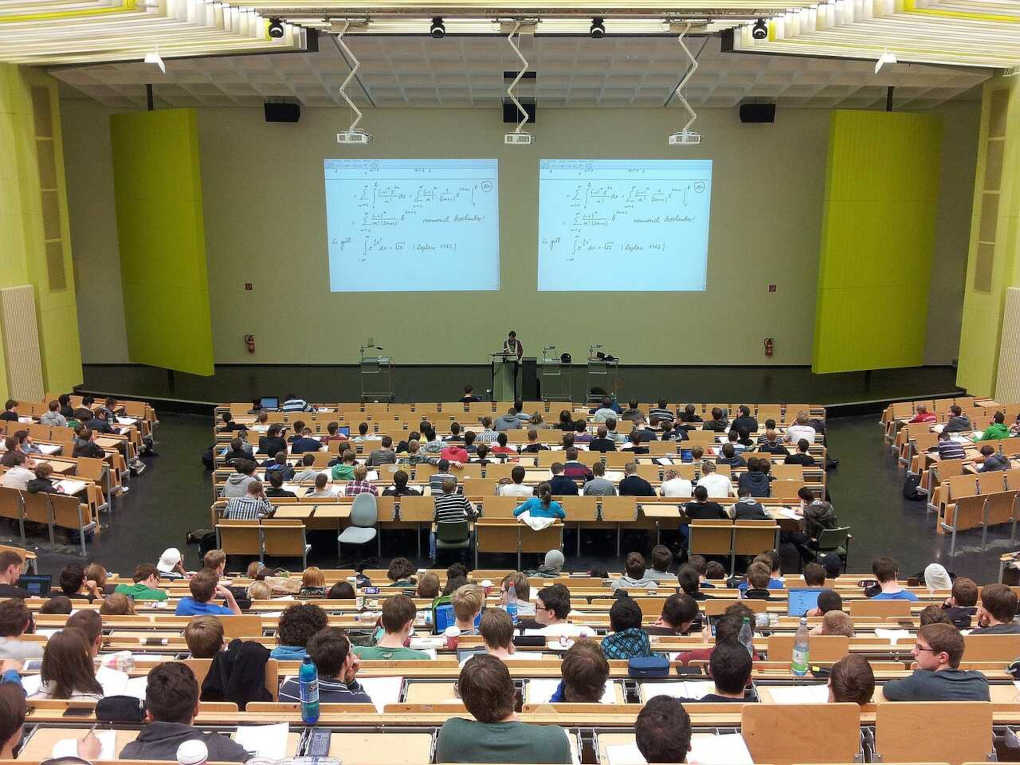 Students sitting in a university lecture theatre listening to the lecturer