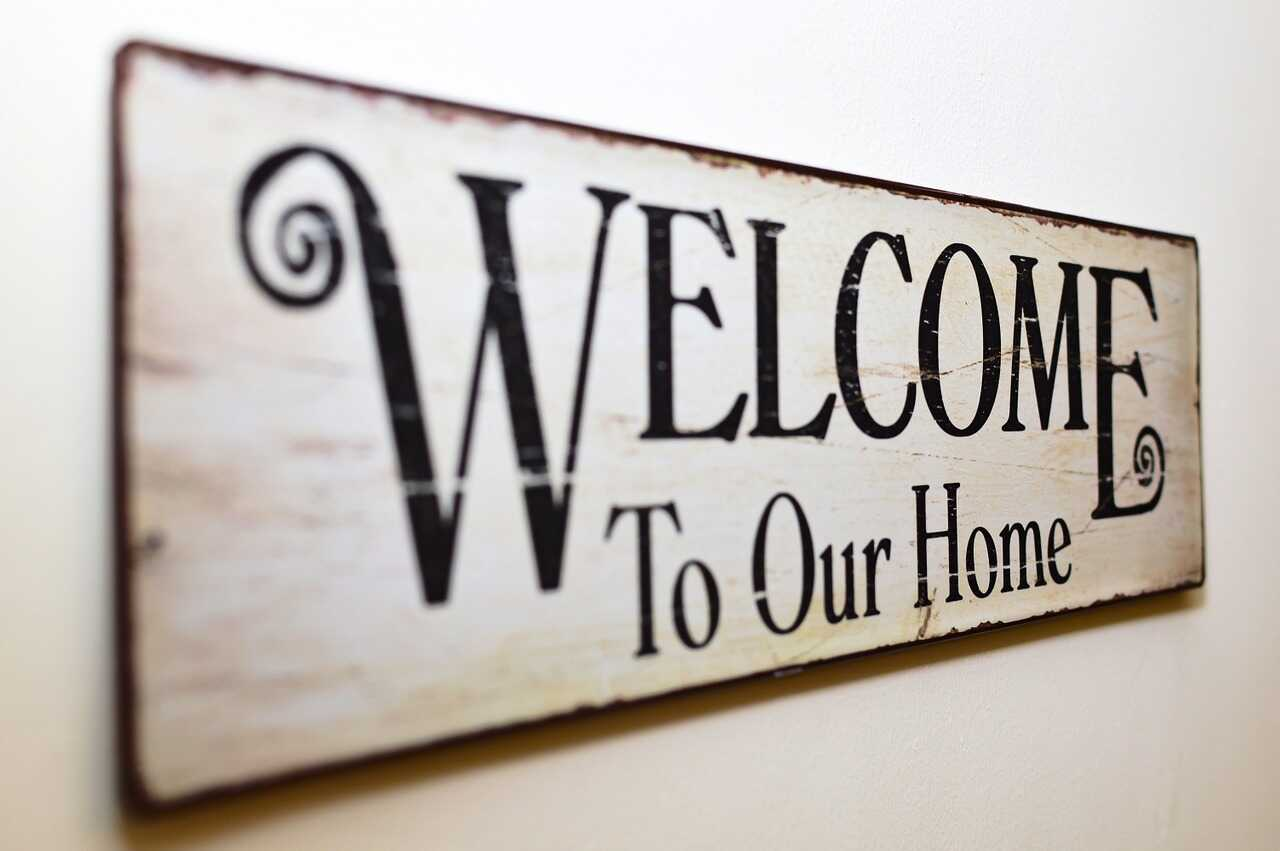 White sign saying welcome to our home on a white background