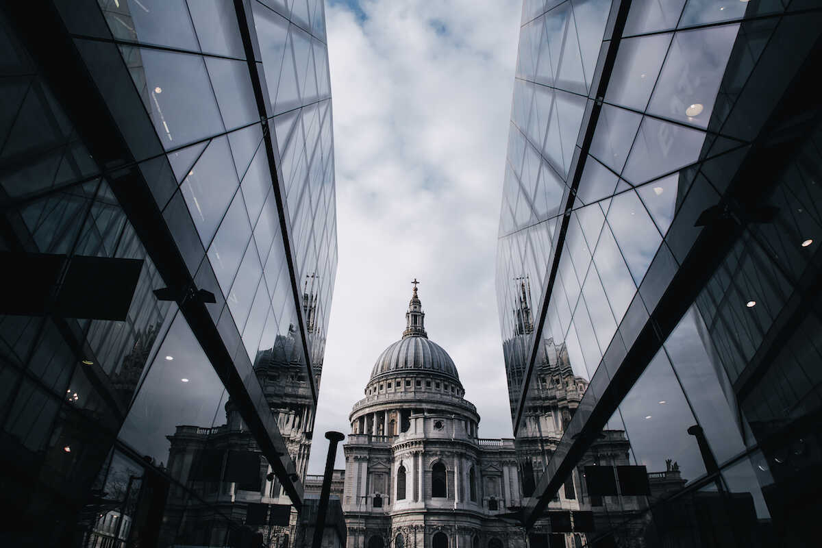 A view of St Pauls Cathedral through glass plated buildings