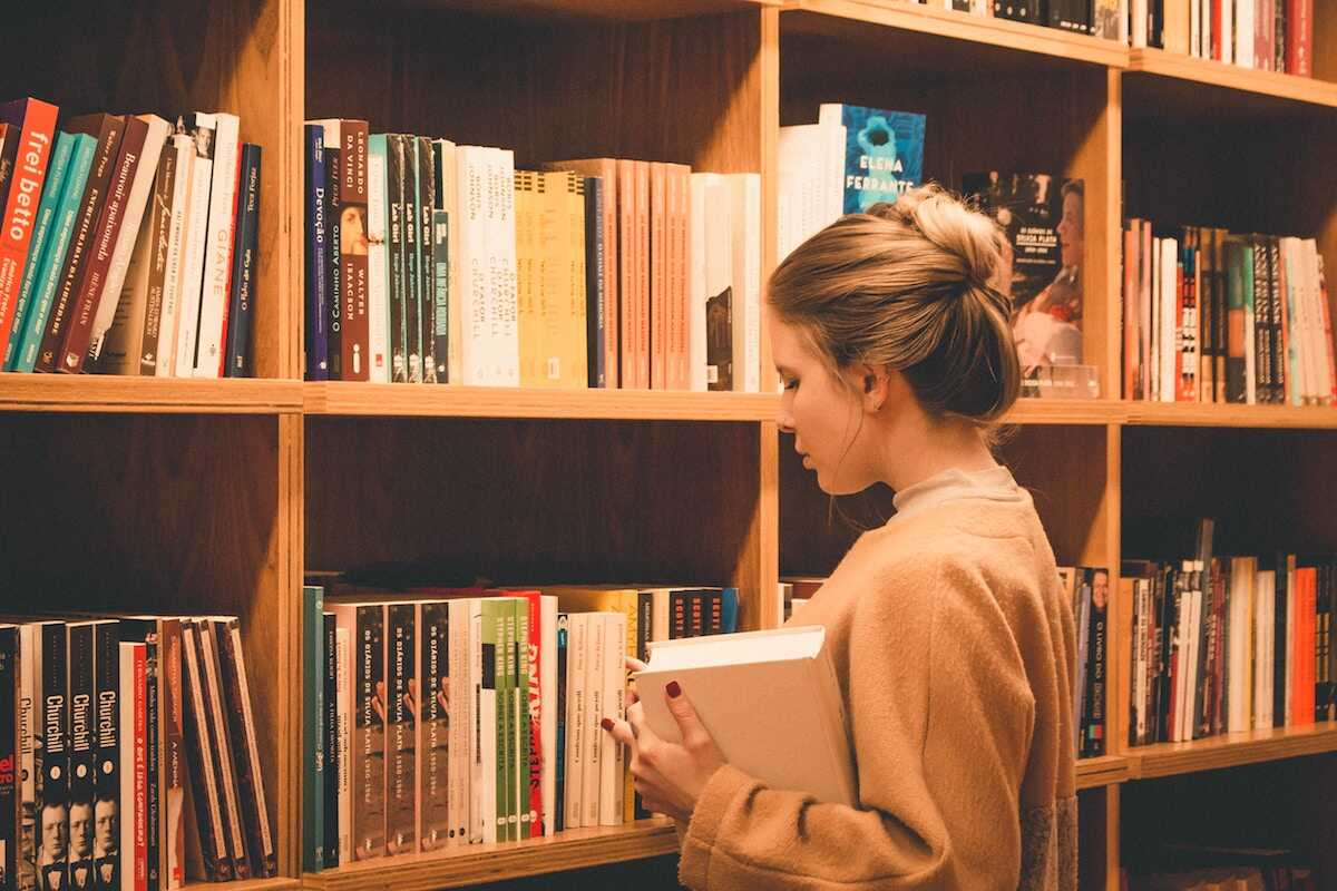Young female browsing in a bookshop