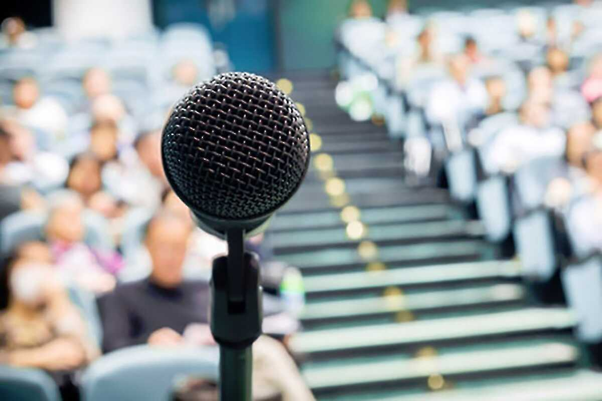 Close up of a microphone facing the audience