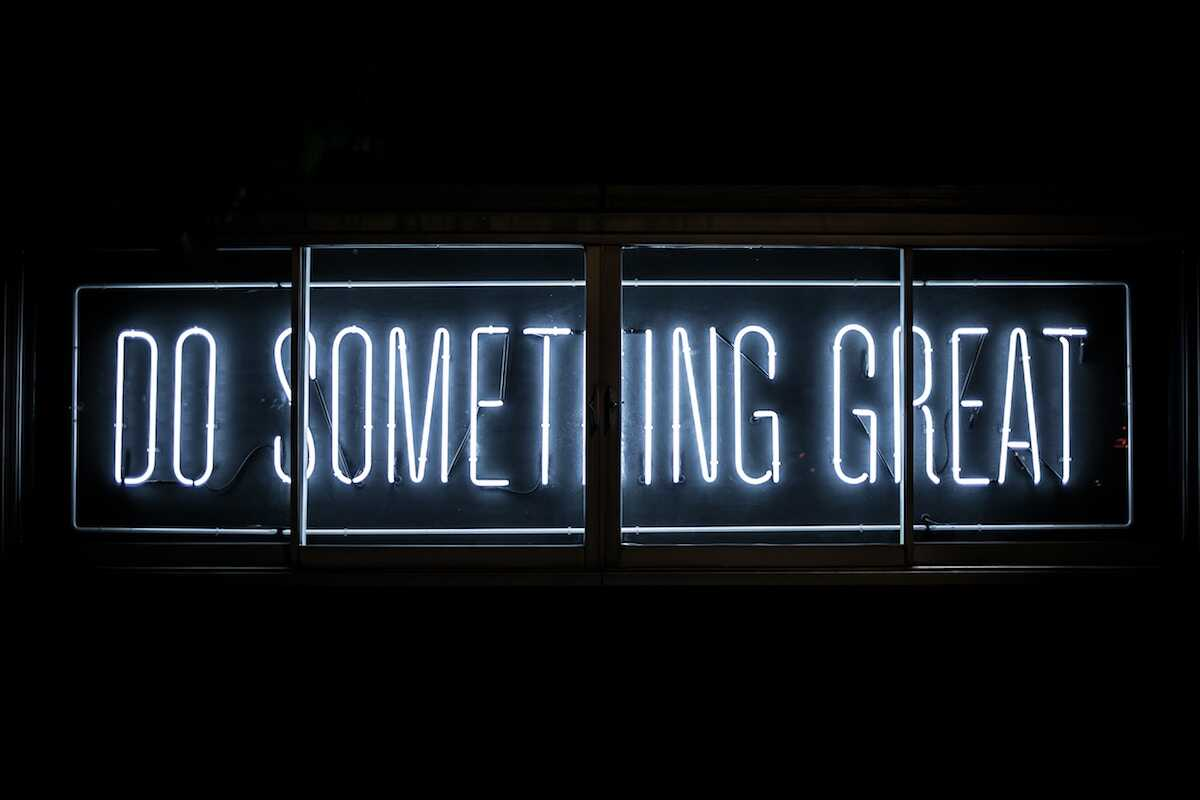 White neon sign saying Do Something Great